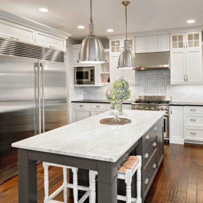 White Kitchen with Stainless Kitchen Appliances